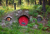 Hobbit house with red door and windowsAdd a Hobbit House to your Fairy Garden we will show you how|fairiehollow.com