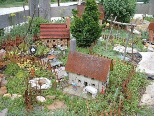 rusted metal roofs stone fairy houses | fairiehollow.com